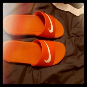 Red Nike slides